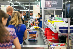 Customers paying for shopping at a supermarket. Line at the cash Royalty Free Stock Photography