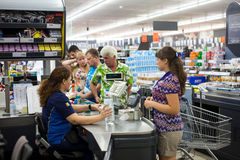 Customers paying for shopping at a supermarket. Line at the cash Royalty Free Stock Images