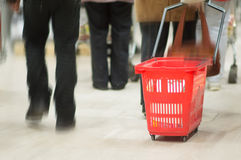 Customers with red baskets in supermarket Stock Photography