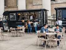 Customers at refreshment truck in courtyard, British Museum, Lon. London, England, August 20, 2015: Customers look at food at refreshment truck in British Museum Stock Photos