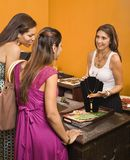 Customers and sales clerk. Stock Images