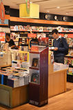 Customers shop for books in Changi Airport, Singapore Stock Image