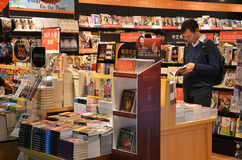 Customers shop for books in Changi Airport, Singapore Stock Photo