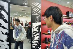 Customers shopping in mall. Of wuhan plaza - converse store interior Stock Photography