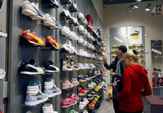 Customers shopping in mall - Puma store interior stock photography