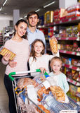 Customers with small children purchasing shortcakes Stock Photo