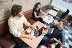 Customers Spending Leisure Time In Cafeteria Royalty Free Stock Photos