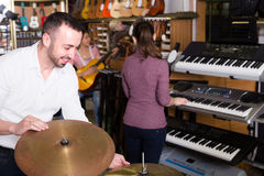 Customers and staff in music shop Royalty Free Stock Photography