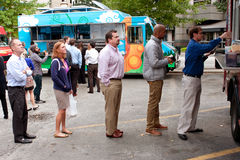 Customers Stand In Line To Order Meals From Food Trucks Stock Image