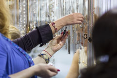 Customers in the store choosing jewelry items Royalty Free Stock Images