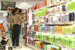 Customers at supermarket. Customers shopping for cosmetics inside a supermarket royalty free stock image