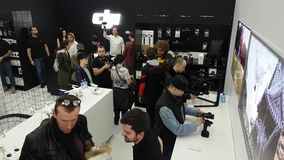 Customers testing Osmo stabilizers at the opening of DJI Store. Moscow, Russia - April 1, 2017: Customers testing Osmo stabilizers at the opening of DJI stock video footage