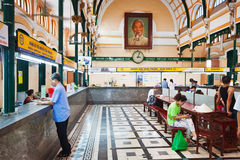 Customers and tourists at the General Post Office in Ho Chi Minh Royalty Free Stock Image