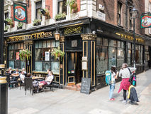 Customers and tourists outside Sherlock Holmes pub on Craven Passage Stock Image