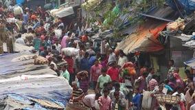 Customers and traders of huge Mullik Ghat Flower Market on old indian street in Kolkata. stock video footage