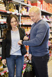 Customers Using Smart Watch In Grocery Store Stock Images