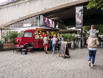 Customers visit bright red snack van, The Riverfront, London Royalty Free Stock Image