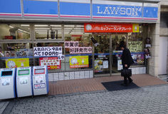 Customers visit Lawson Station store in Hiroshima, Japan. HIROSHIMA, JAPAN - APRIL 22: Customers visit Lawson Station store on April 22, 2012 in Hiroshima, Japan Royalty Free Stock Photos