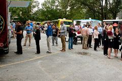 Customers Wait In Line To Order Meals From Food Trucks royalty free stock photography
