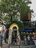 Customers wait outside Moulin de la Galette on Montmartre in Paris Stock Photography