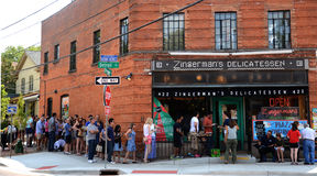 Customers wait to go into Zingerman's Royalty Free Stock Photos
