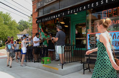 Customers wait to go into Zingerman's Royalty Free Stock Images