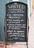 Customers wanted sign. Coffee shop street sign, willing to train customers stock photos