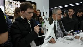 Customers watch quadrocopters at the opening of DJI Store. Moscow, Russia - April 1, 2017: Customers watch quadrocopters at the opening of DJI Authorized Store stock footage