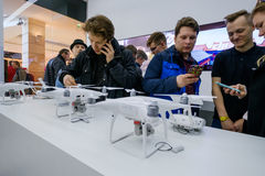 Customers watch quadrocopters at the opening of DJI Store Stock Images