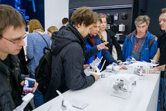 Customers watch quadrocopters at the opening of DJI Store Stock Photo