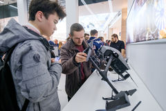 Customers watch quadrocopters at the opening of DJI Store Stock Photos