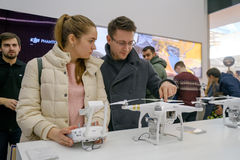 Customers watch quadrocopters at the opening of DJI Store Royalty Free Stock Photography