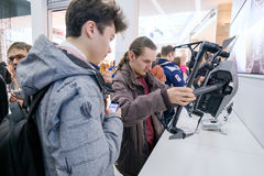 Customers watch quadrocopters at the opening of DJI Store Royalty Free Stock Images