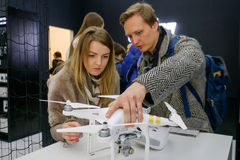 Customers watch quadrocopters at the opening of DJI Store Royalty Free Stock Image