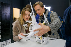 Customers watch quadrocopters at the opening of DJI Store Stock Photography