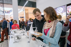 Customers watch quadrocopters at the opening of DJI Store Stock Image