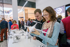 Customers watch quadrocopters at the opening of DJI Store Royalty Free Stock Photos