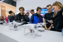 Customers watch quadrocopters at the opening of DJI Store Royalty Free Stock Photo
