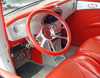 Customised car interior. Photo of a luxury red and silver leather trim car interior taken 16th july 2017 Royalty Free Stock Images
