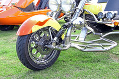 Customised chopper trike front wheel. Photo of a customised chopper trike wheel showing brake disc detail and nice chrome work on forks.photo taken 8th june 2013 Stock Photography