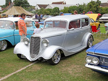 Customised ford gangster car. Photo of a silver customised ford gangster car with chrome alloy wheels showing at herne bay car show on 28th june 2015 Stock Photography