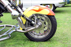 Customised front bike wheel. Photo of a customised motorbike wheel with lots of chrome and flame mudguard Royalty Free Stock Photography