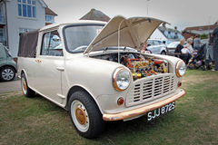Customised mini engine. Photo of a customised mini with brightly painted engine in various colours with brass bumper and trims on display at whitstable 21st Stock Images