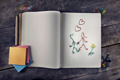 Customizable love messages with lovers made from paper clips on vintage notebook Stock Images