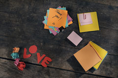 Customizable messages of appreciation and love. Customizable messages of love and appreciation using post-its on a vintage table Royalty Free Stock Photography