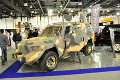 Customized Armored SUV. Armored SUV Car in camouflage paint in Dubai Motor Show 2011 stock image