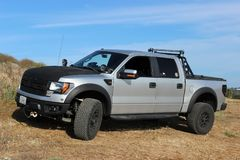 A customized Ford F-150 Raptor SVT on a dirt road stock images