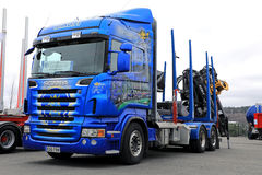 Customized Blue Scania Logging Truck on Display stock photo