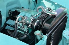 Customized car engine. Closeup of customized car engine in classic vehicle Royalty Free Stock Image