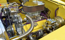Customized car engine. Closeup of customized engine in yellow motor car Royalty Free Stock Photo